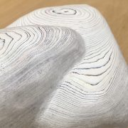 detail photograph of smooth carved layered paper sculpture by Simone Cupello