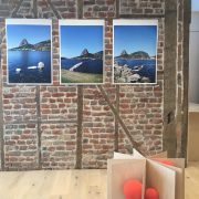 3 coloured landscape photos of Rio by Marcos Chaves on the brick gallery wall