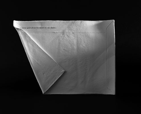 "Ceramic envelope with the words ""keep quiet about the secret we share"" artwork by Julie Derbyshire, Possession 1"
