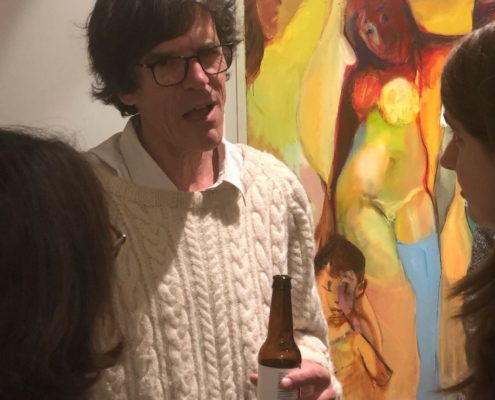 photo of Simon Klein at the Opening of his show with a beer in his hand