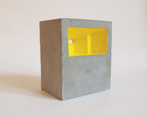 unpainted concrete block with yellow interior