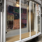 The Sounds Paintings make- view of abstract painting in gallery window