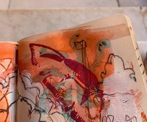 sketch book with orange abstract painting with indian block printing textures