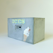 concrete block with ices text and an icecream cone painted on the side